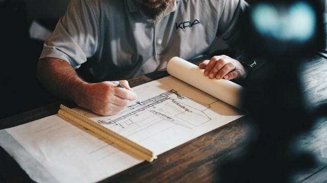 A contractor drawing a project he is working on.
