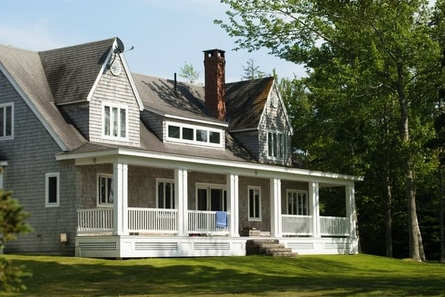 A beautiful house with a large white porch.