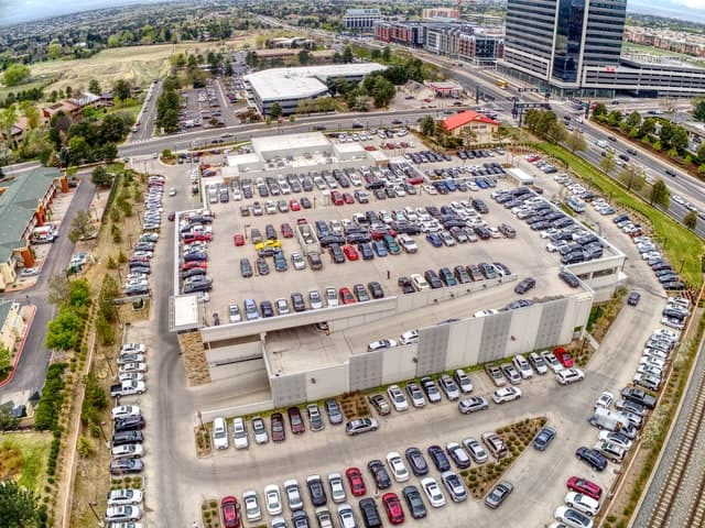 Large auto dealership filmed from above.