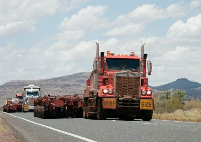 Large trucks driving without cargo.